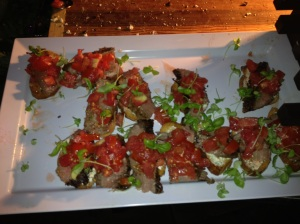 Dirty Grilled Flank Steak Bruschette with Jersey Tomato and Goat Cheese Spread w/ Micro Greens