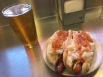hot dogs with kraut and onions  and a beer